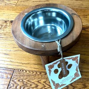 Solid wood and stainless steel dog raised bowl.